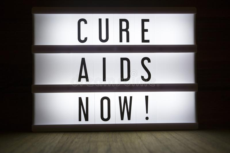Cure AIDS now!. `Cure AIDS now` text in lightbox royalty free stock photography