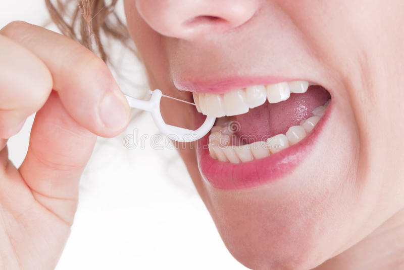 Cure odontoiatriche con filo per i denti fotografie stock libere da diritti