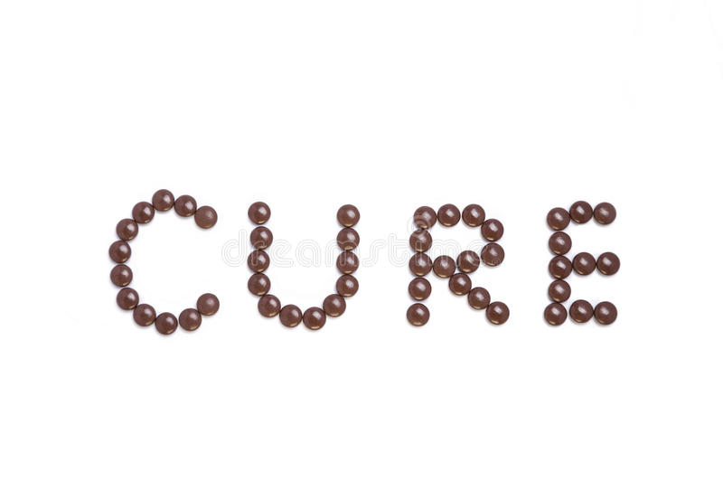 Cure written with brown pills vector illustration