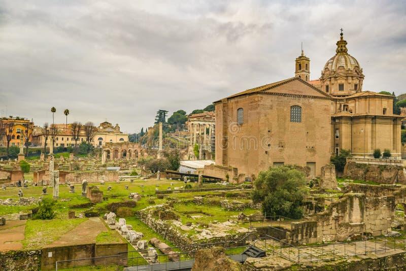 Curia Julia och Santi Luca e Martina Church arkivfoton