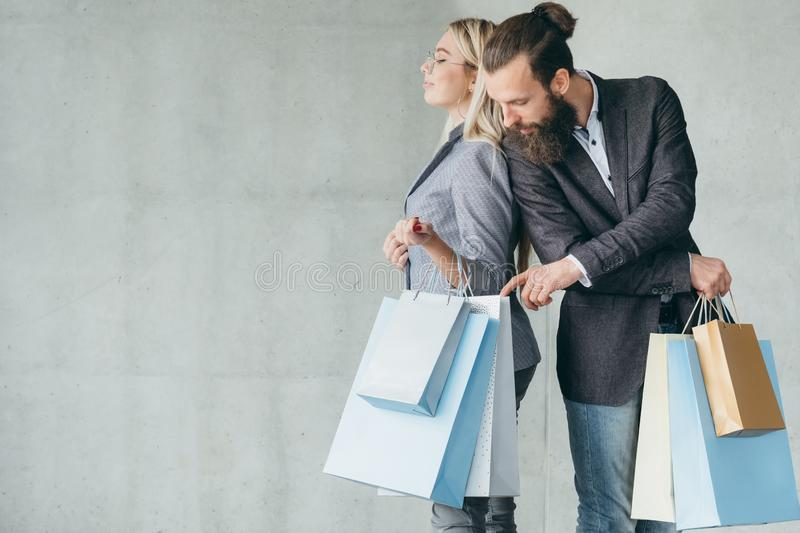 Curiosity buy addict man interested shopping bags. Curiosity and buying addiction. men interested in womans shopping bags and stuff she purchased royalty free stock photography