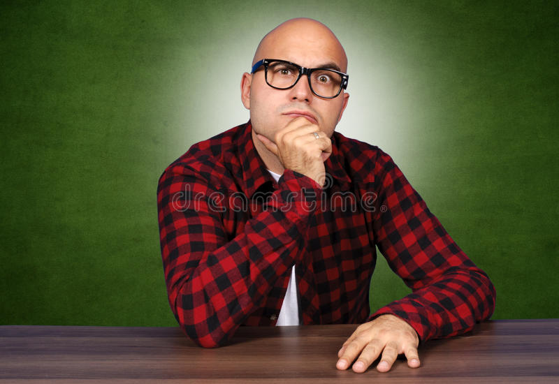 Curiosity man. Curiosity bald man with sunglasses stock image