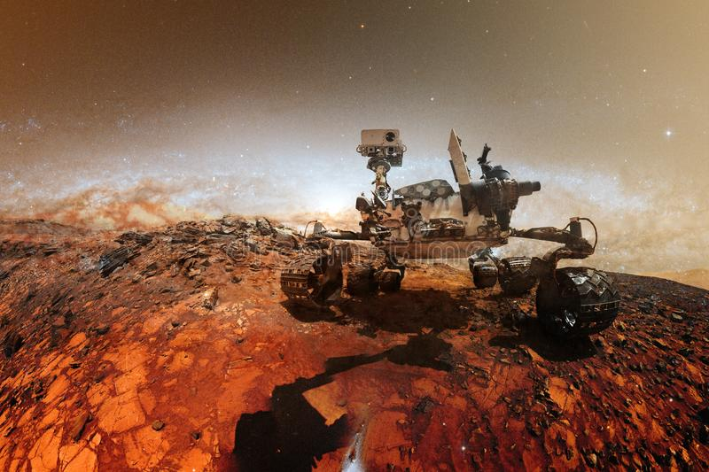 Curiosity Mars Rover exploring the surface of red planet. Elements of this image furnished by NASA stock photos