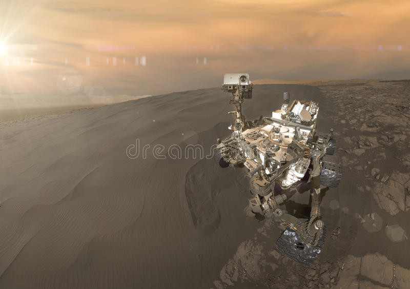 Curiosity rover exploring the surface of Mars. Retouched image. Elements of this image furnished by NASA stock photo