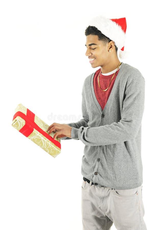 Curioso sobre seu presente do Natal foto de stock royalty free