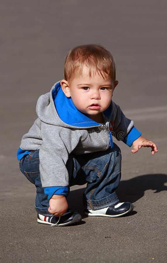 Curious child on the road. Curious child sitting on the road royalty free stock photography