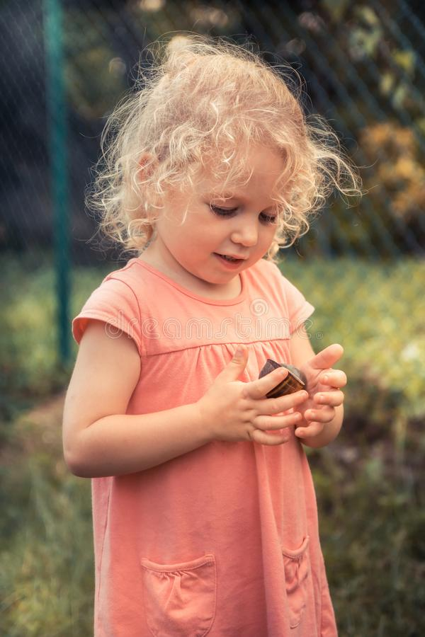 Curious child toddler playing with big snail concept childhood curiosity lifestyle royalty free stock images