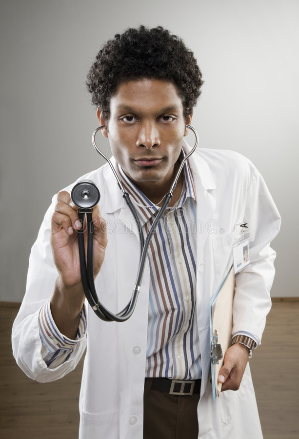 Download Curious Doctor In Lab Coat Holding Stethoscope Stock Photography - Image: 6747082