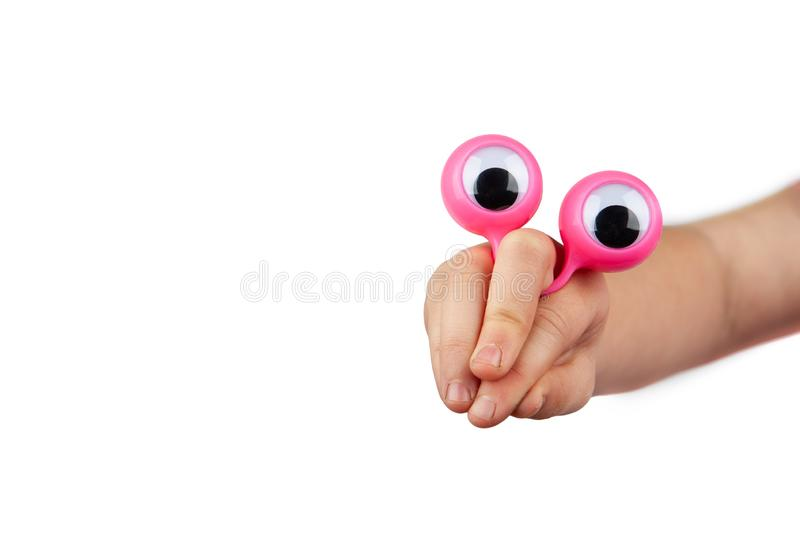Curious  funny face made with child hand and googly eyes. Curious and inquisitive funny face made with child hand and googly eyes isolated on white background stock photography