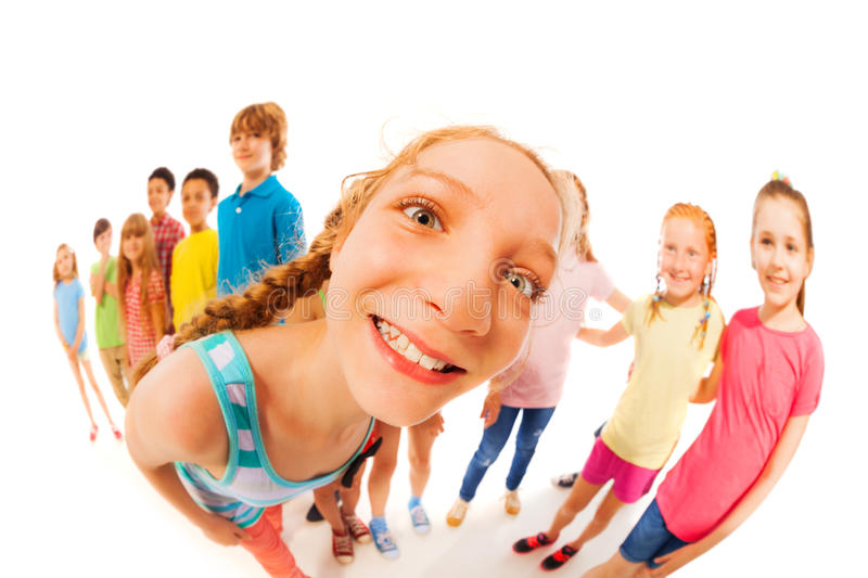 Curious funny girl in large group of friends stock image