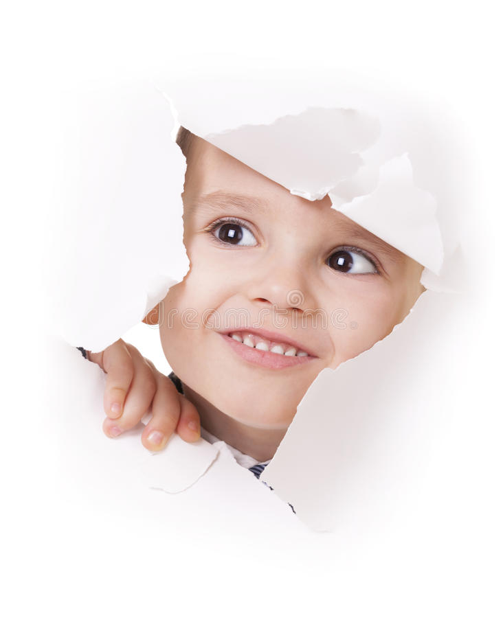 Free Curious Kid Looks Through A Hole In White Paper Stock Images - 26044464