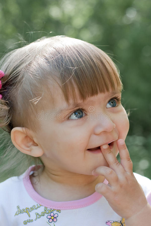 Curious Little Girl Outdoor Portrait In Summer Stock Photo