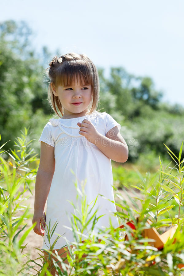 Curious little model posing in park. Image of curious little model posing in park stock image