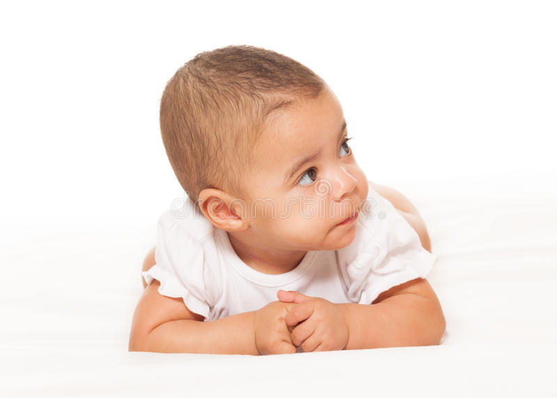 Curious looking African baby in white bodysuit royalty free stock photos