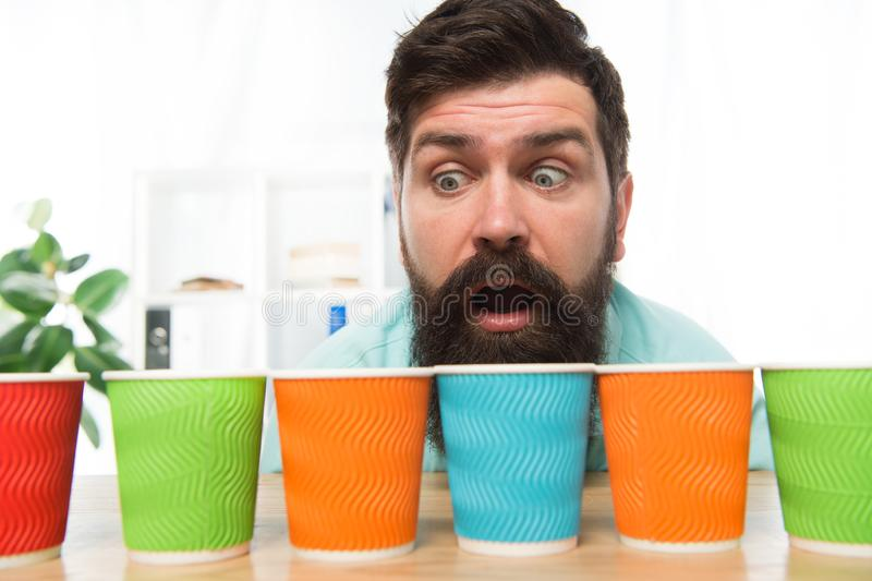 Curious man looks on colorful coffee cups. Color your day. Different types of coffee drinks in cafe menu. large. Assortment. assortment of coffee. energy drink stock images