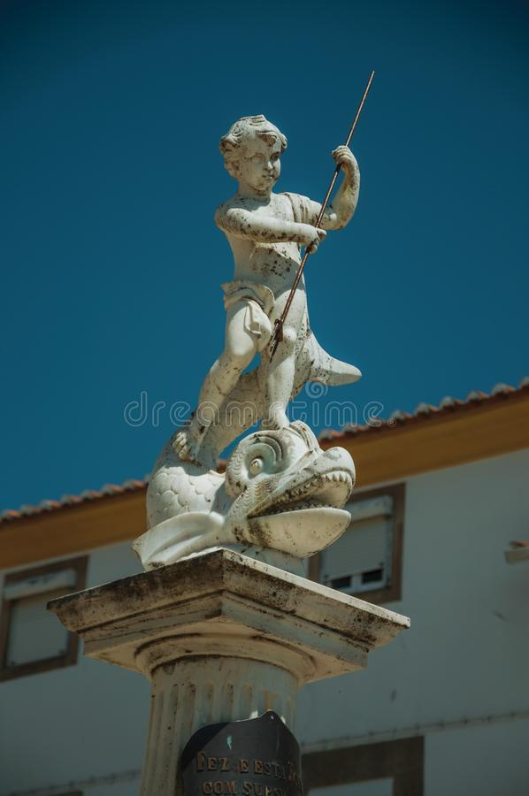 Curious marble statue on top of pillar stock image
