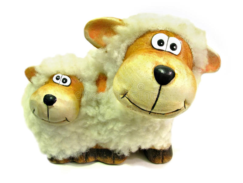 Curious nosey sheep. Photo of two curious nosey sheep looking into the camera lens stock image