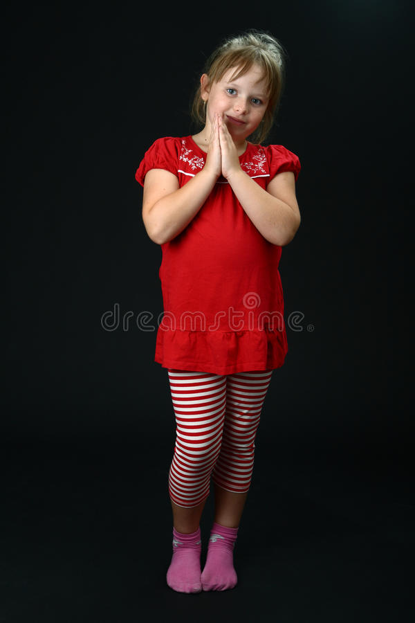 Download Curious Small Girl With Clasped Hands Smiling Stock Photo - Image: 16129854