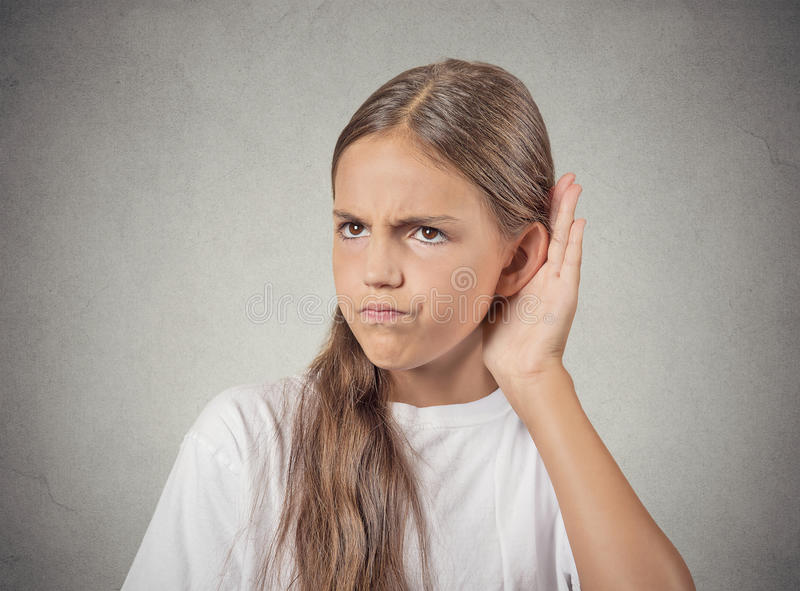 Curious teenager girl hand to ear, listening to gossip royalty free stock photography