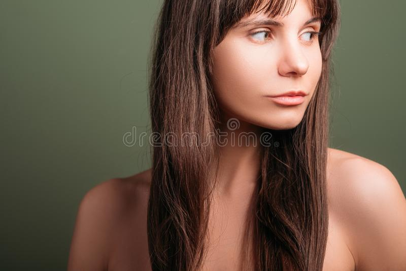 Curious watchful relaxed emotion girl portrait. Watchful beautiful girl. Curious facial expression. Closeup portrait of emotional brunette lady with bare royalty free stock photos