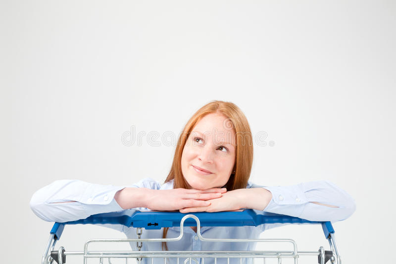 Curious Woman with a Shopping Cart stock photography