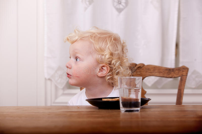 Curious Young Boy at Table royalty free stock images