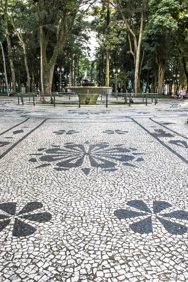 Mosaic made with portuguese stones in the pavement of General Osório square stock photos