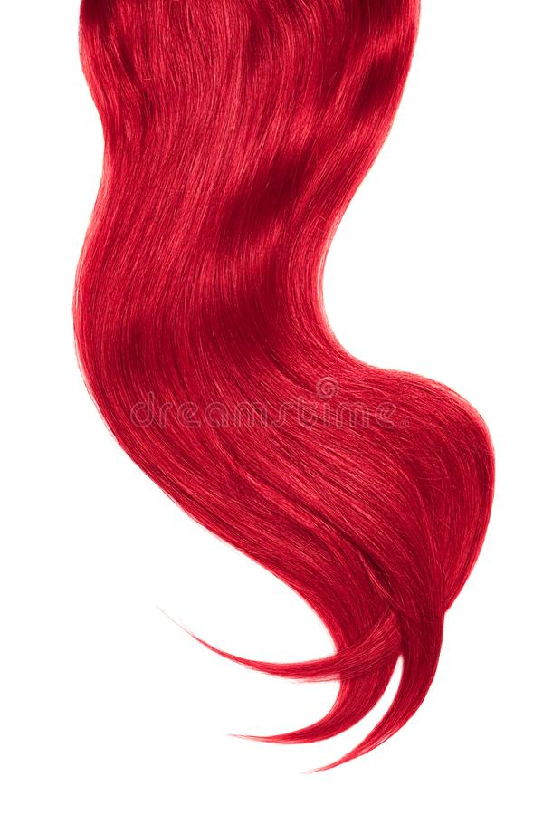 Curl of natural pink hair on white background. Wavy ponytail stock photography
