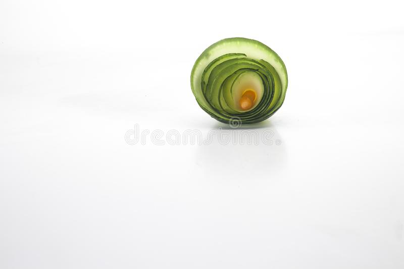Curl viewed frontally from a zucchini. On a white background royalty free stock image