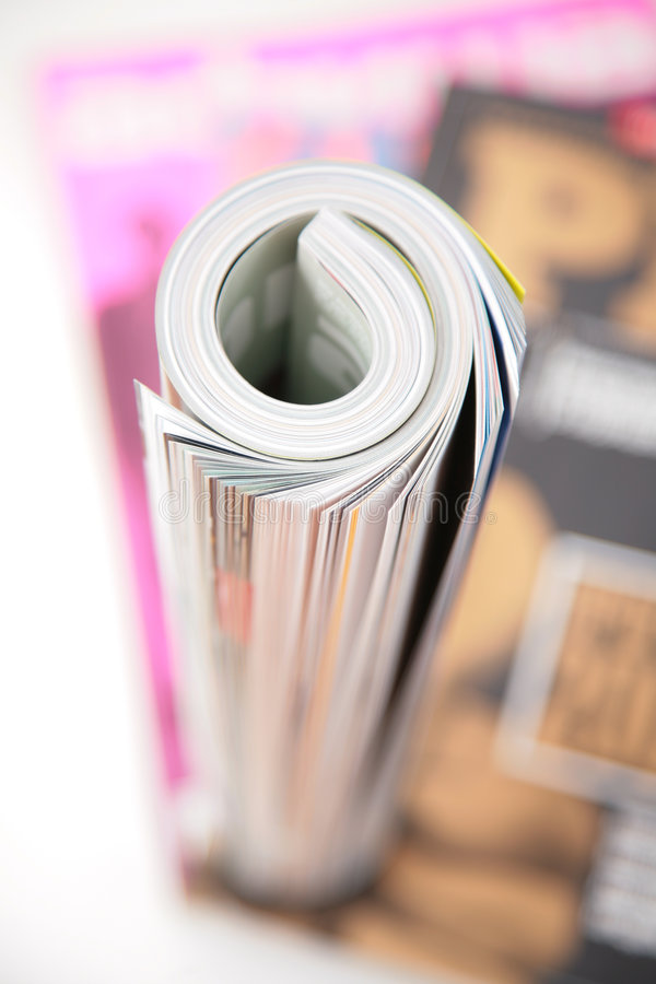 Download Curled magazine top view stock image. Image of magazines - 4056885