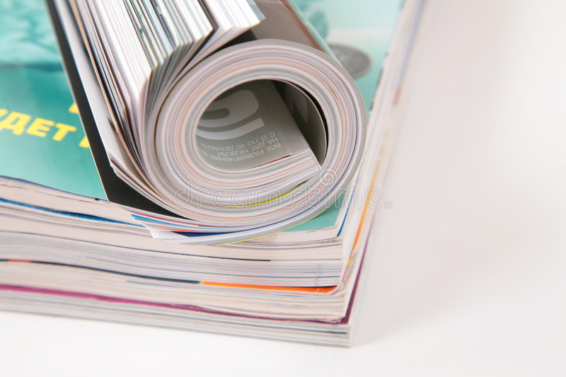 Curled magazined on stack royalty free stock photos