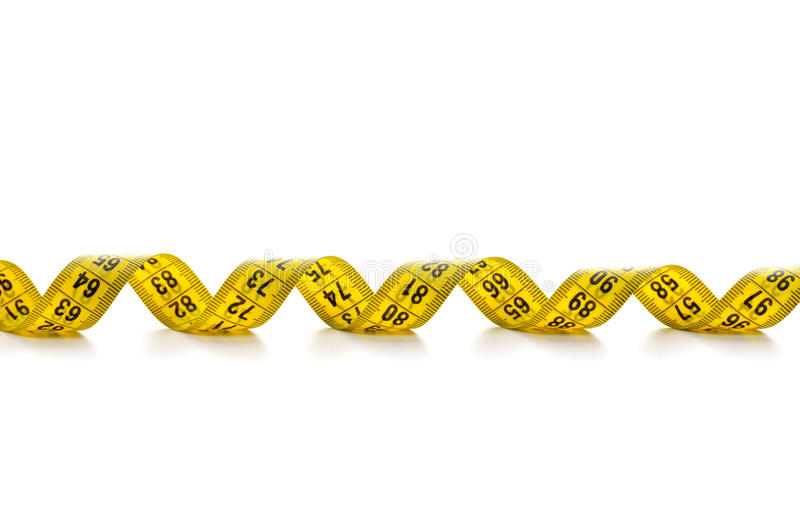 Curled spiral tape measure royalty free stock images