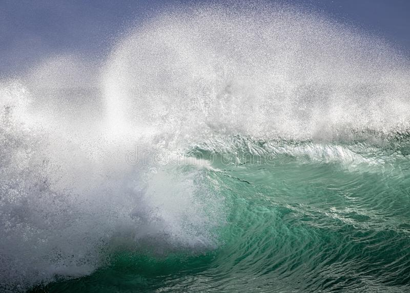 Curling and Breaking Wave in Green and White stock images
