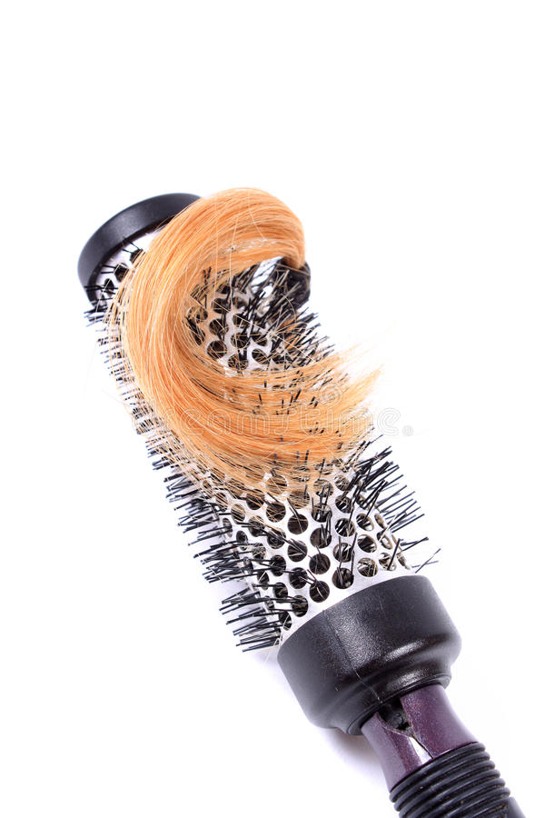 Curling brush and blonde hair royalty free stock photo