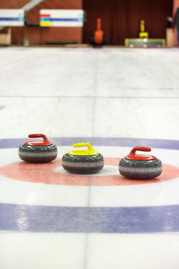 Two Granite Stones For Curling Game On The Ice Stock Photo