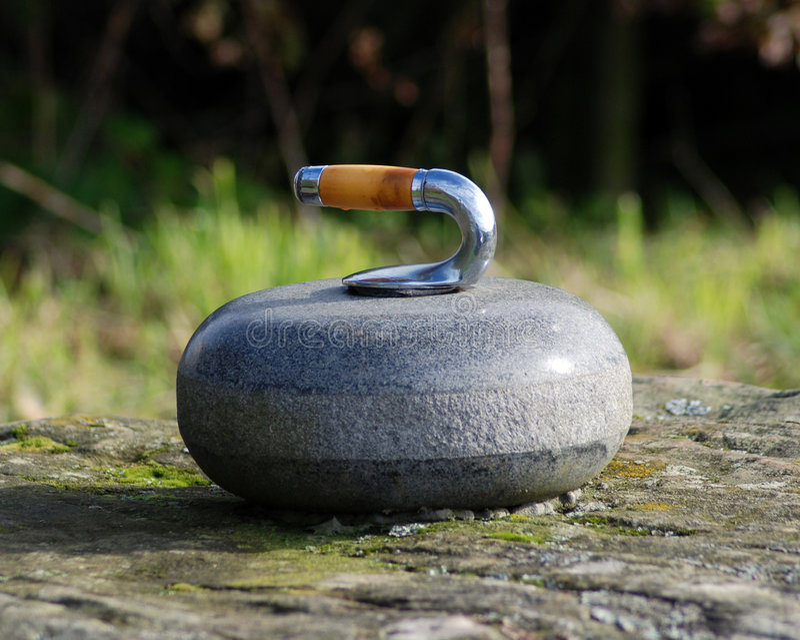 Curling stone close up stock photos
