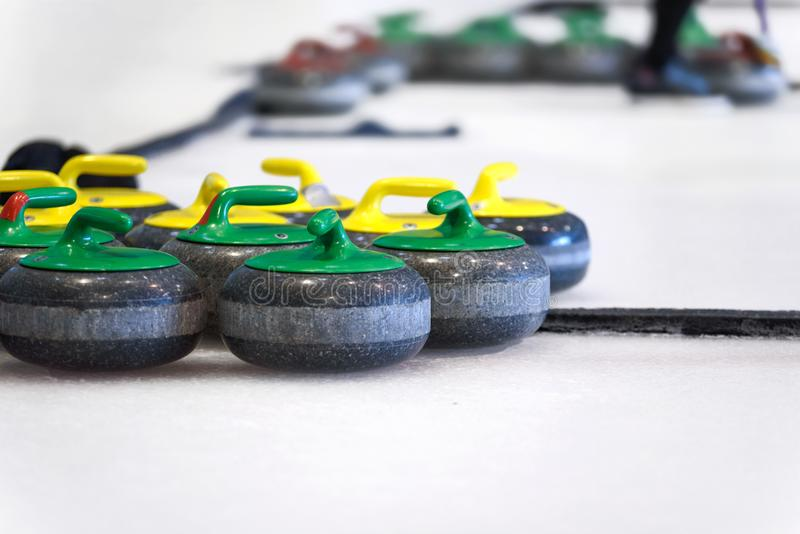 Curling stones on the ice. Curling stones equipment on the ice in close-up stock photos