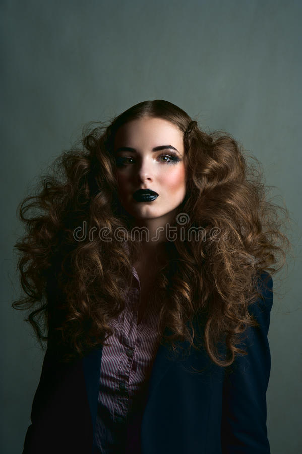 Curly brunette girl with black lips royalty free stock images