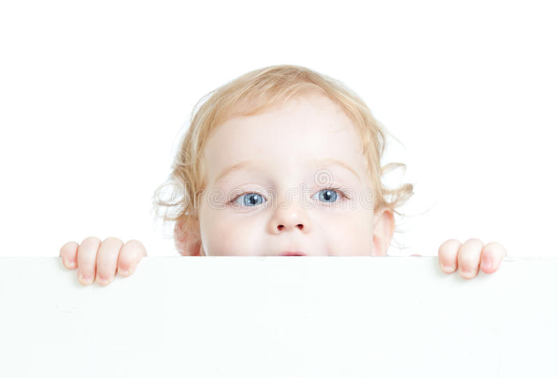 Curly cute child holding blank advertising banner royalty free stock image