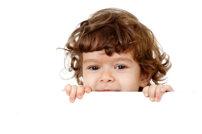 Curly funny child face holding banner stock image