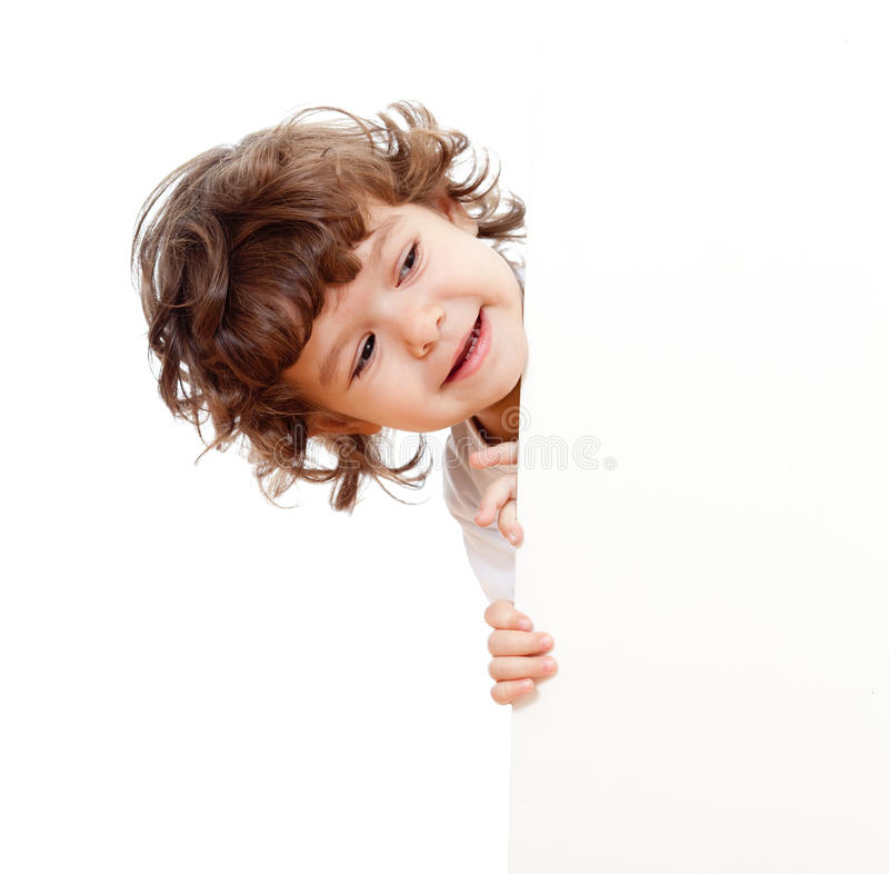 Curly funny child holding blank advertising stock photos