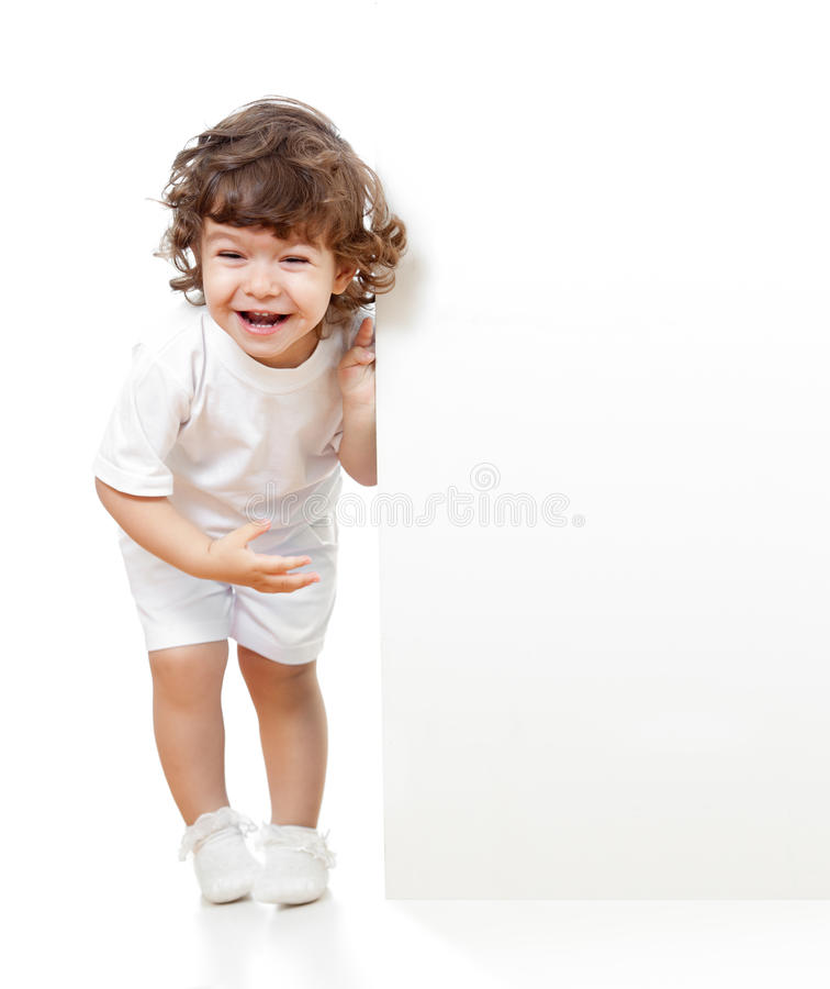 Curly funny girl holding blank advertising banner royalty free stock images
