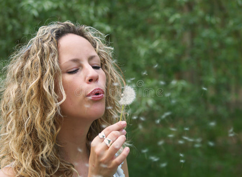 Curly Girl Blow Dandelion Royalty Free Stock Photo