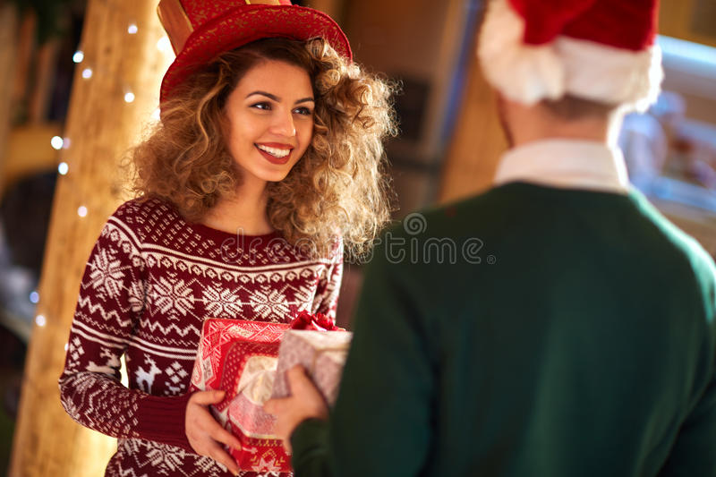 Curly girl exchanges gifts with boyfriends royalty free stock photos