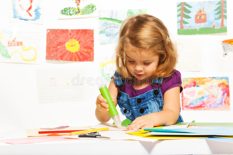 Curly Girl With Glue Stick Royalty Free Stock Photo