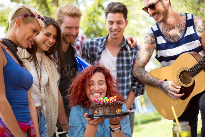 Curly girl is so much happy with birthday surprise and great fri royalty free stock images