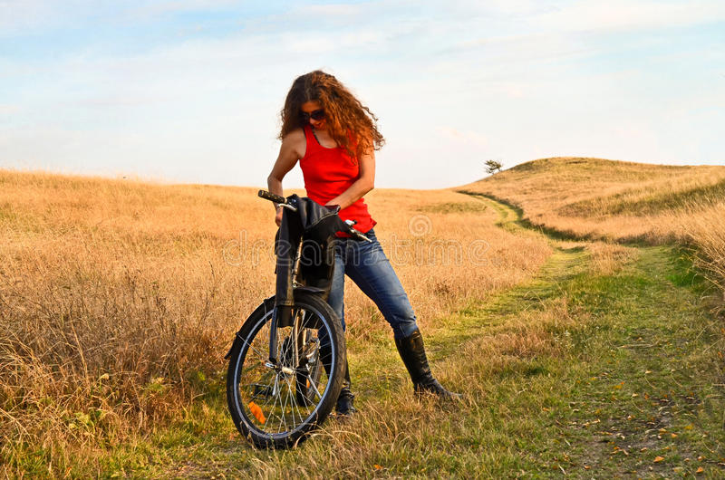 Curly Haired Lady Cyclist stock photos
