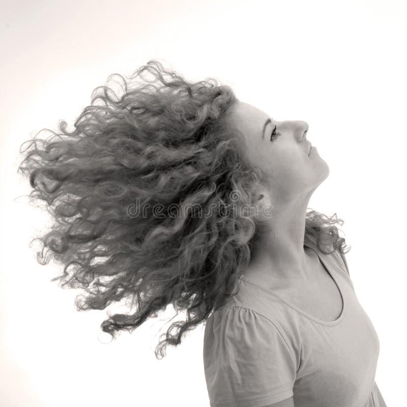 Curly-haired Mädchen lizenzfreies stockbild