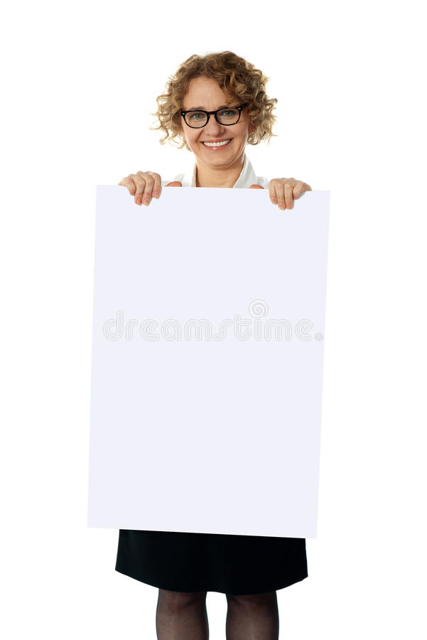 Download Curly Haired Woman Holding Advertising Board Stock Photo - Image: 25761856