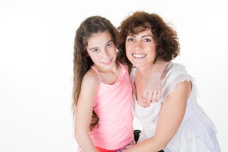 Mother hug pre teenager pretty daughter girl royalty free stock photography